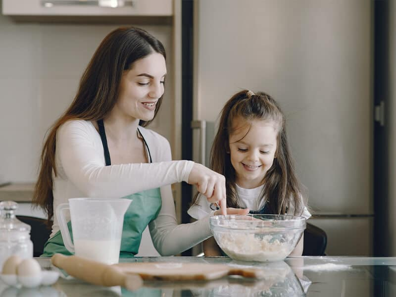 daughter and mother baking